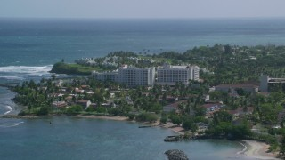 AX101_217 - 5k stock footage aerial video of a Hotel situated on the coast and pristine blue water, Dorado, Puerto Rico