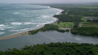 AX101_220 - 5k stock footage aerial video Following the beach over a lagoon on the coast, Dorado, Puerto Rico