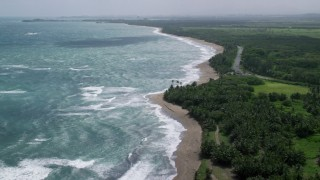 AX101_221 - 5k stock footage aerial video Following the beach and highway along crystal blue waters, Dorado, Puerto Rico