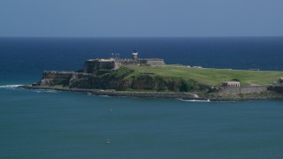 AX101_235 - 5k stock footage aerial video of Fort San Felipe del Morro surrounded by crystal blue waters, Old San Juan Puerto Rico