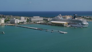 AX101_237 - 5k stock footage aerial video of a Cruise ship in crystal blue waters, Port of San Juan, Puerto Rico