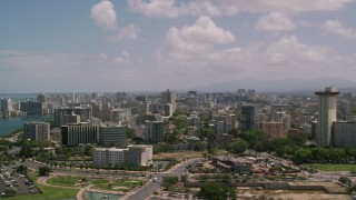 AX102_001 - 5k stock footage aerial video of an Apartment and office buildings near the water, San Juan, Puerto Rico
