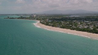 AX102_005 - 5k stock footage aerial video of Beaches and coastal community along crystal blue water, San Juan, Puerto Rico