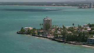 AX102_007 - 5k stock footage aerial video of oceanfront homes and track kite surfer over pristine blue water, San Juan, Puerto Rico