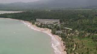 AX102_038 - 5k stock footage aerial video of Turquoise waters and beachside condominiums, Rio Grande, Puerto Rico