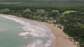 AX102_040 - 5k stock footage aerial video of a Beachside resort, St. Regis, Rio Grande, Puerto Rico