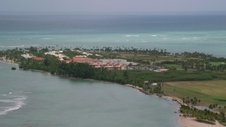 AX102_041 - 5k stock footage aerial video of a Golf resort along clear turquoise waters, Gran Melia Golf Resort, Puerto Rico