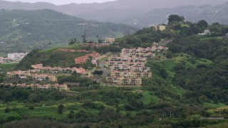 AX102_044 - 5k stock footage aerial video of Condos on a tree covered hillside, Rio Grande, Puerto Rico