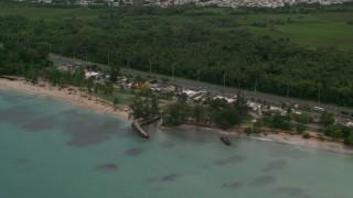 AX102_048 - 5k stock footage aerial video Highway along the beach toward beach community, Luquillo, Puerto Rico