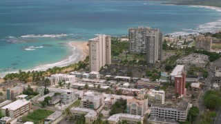 AX102_050 - 5k stock footage aerial video Flying over condos and beachfront property, Luquillo, Puerto Rico
