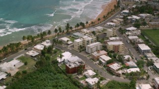 AX102_051 - 5k stock footage aerial video of a Beachfront property and crystal blue water, Luquillo, Puerto Rico
