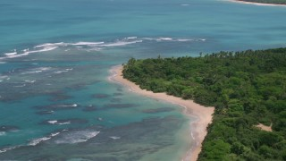 AX102_054 - 5k stock footage aerial video of Reefs among crystal blue waters along the beach, Luquillo, Puerto Rico