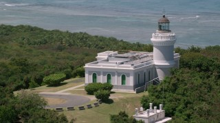 AX102_064 - 5k stock footage aerial video Orbiting Cape San Juan Light, Puerto Rico