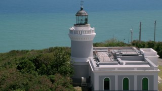 AX102_067 - 5k stock footage aerial video Orbiting Cape San Juan Light with ocean views, Puerto Rico