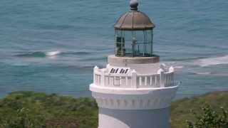 AX102_068 - 5k stock footage aerial video Orbiting Cape San Juan Light and crystal blue water, Puerto Rico