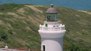 AX102_069 - 5k stock footage aerial video Orbiting the top of the Cape San Juan Light, Puerto Rico