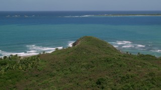 AX102_071 - 5k stock footage aerial video Flying over a cliff to crystal clear blue water, Fajardo, Puerto Rico