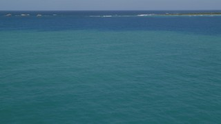 AX102_072 - 5k stock footage aerial video Flying over crystal clear blue tropical waters, Rada Fajardo, Puerto Rico