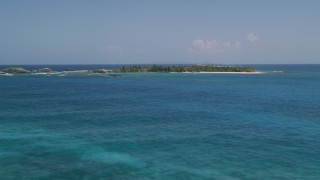 AX102_083 - 5k stock footage aerial video Flying over tropical blue waters toward a small island, Puerto Rico