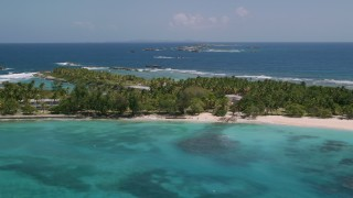 AX102_084 - 5k stock footage aerial video Flying over island and tropical blue waters, Puerto Rico