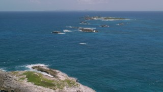 AX102_087 - 5k stock footage aerial video of a Tiny island in tropical blue waters, Puerto Rico