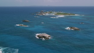 AX102_088 - 5k stock footage aerial video of a Tiny green island in tropical blue waters, Puerto Rico