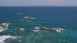AX102_090 - 5k stock footage aerial video of a Tiny rocky islands in sapphire blue waters, Puerto Rico