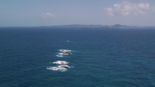 AX102_100 - 5k stock footage aerial video Approaching a larger island in sapphire blue waters, Culebra, Puerto Rico
