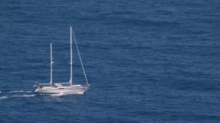AX102_106 - 5k stock footage aerial video of a Sail boat in sapphire blue waters, Culebra, Puerto Rico