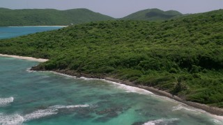 AX102_111 - 5k stock footage aerial video of Sapphire blue waters along a green coastline, Culebra, Puerto Rico