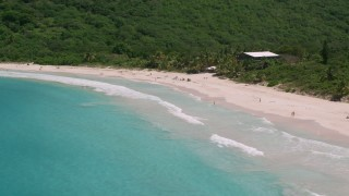 AX102_113 - 5k stock footage aerial video of Sapphire blue waters and beachgoers on white sand Caribbean Flamenco Beach, Culebra, Puerto Rico