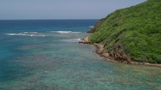 AX102_114 - 5k stock footage aerial video of Sapphire blue waters along a rugged coastline, Culebra, Puerto Rico
