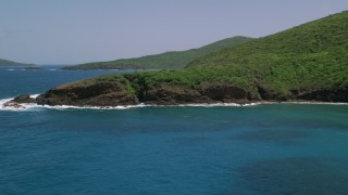 AX102_115 - 5k stock footage aerial video of Sapphire blue waters against a rugged coastline, Culebra, Puerto Rico