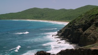 AX102_116 - 5k stock footage aerial video of Sapphire blue waters along a Caribbean beach and lush vegetation, Culebra, Puerto Rico
