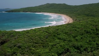 AX102_121 - 5k stock footage aerial video of Coastal vegetation and sapphire blue waters, Culebra, Puerto Rico