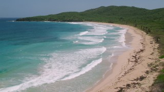 AX102_123 - 5k stock footage aerial video of Sapphire blue waters along a Caribbean beach, Culebra, Puerto Rico