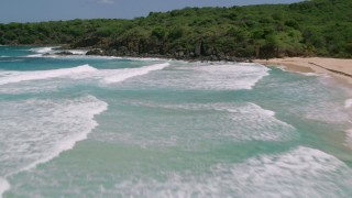 AX102_125 - 5k stock footage aerial video of Sapphire blue waters along a coast with lush vegetation, Culebra, Puerto Rico
