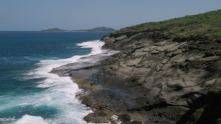 AX102_127 - 5k stock footage aerial video Flying along rugged coast and sapphire blue waters, Culebra, Puerto Rico