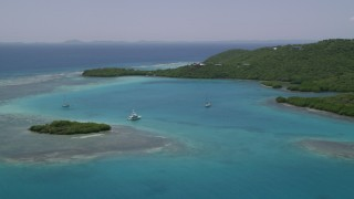 AX102_136 - 5k stock footage aerial video of a Fishing boat and sailboats in turquoise blue waters along the coast, Culebra, Puerto Rico