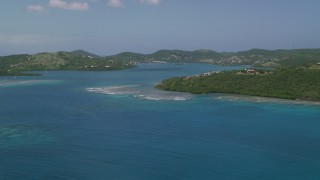 AX102_139 - 5k stock footage aerial video of Sapphire blue waters and a coastal town, Culebra, Puerto Rico