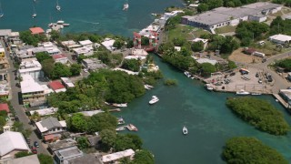 AX102_147 - 5k stock footage aerial video of a Coastal town on sapphire blue waters, Culebra, Puerto Rico