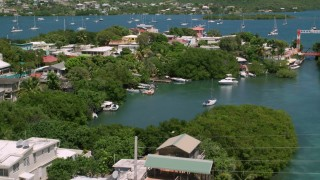 AX102_151 - 5k stock footage aerial video of a Coastal town on sapphire water, Culebra, Puerto Rico