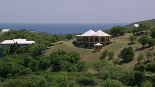 AX102_154 - 5k stock footage aerial video of a Hilltop home with ocean views, Culebra, Puerto Rico