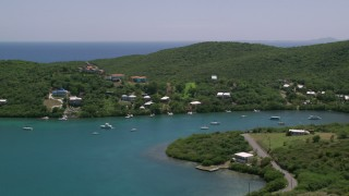 AX102_155 - 5k stock footage aerial video of Oceanfront homes along sapphire waters, Culebra, Puerto Rico