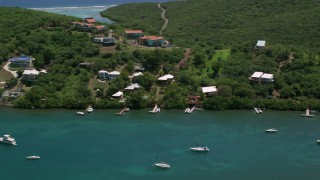 AX102_156 - 5k stock footage aerial video of Oceanfront homes along sapphire blue waters, Culebra, Puerto Rico