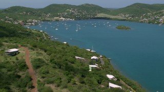 AX102_160 - Aerial stock footage of Sailboats in sapphire blue waters near the coast, Culebra, Puerto Rico
