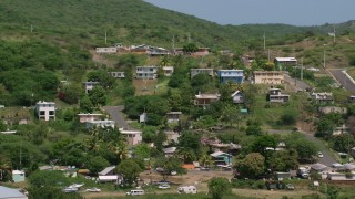 AX102_165 - 5k stock footage aerial video of Residential neighborhoods on a hillside, Culebra, Puerto Rico