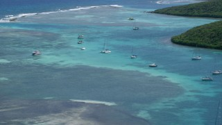 AX102_169 - 5k stock footage aerial video of Sailboats docked in turquoise waters near the coast, Culebra, Puerto Rico