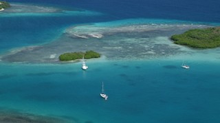 AX102_172 - 5k stock footage aerial video of a Fishing boat near a reef in turquoise waters, Culebra, Puerto Rico