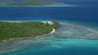 AX102_173 - 5k stock footage aerial video of an Oceanfront home along a reef, Culebra, Puerto Rico